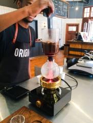 Happy Origin Barista making Siphon coffee