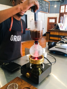 Happy Origin Barista making Siphon coffee